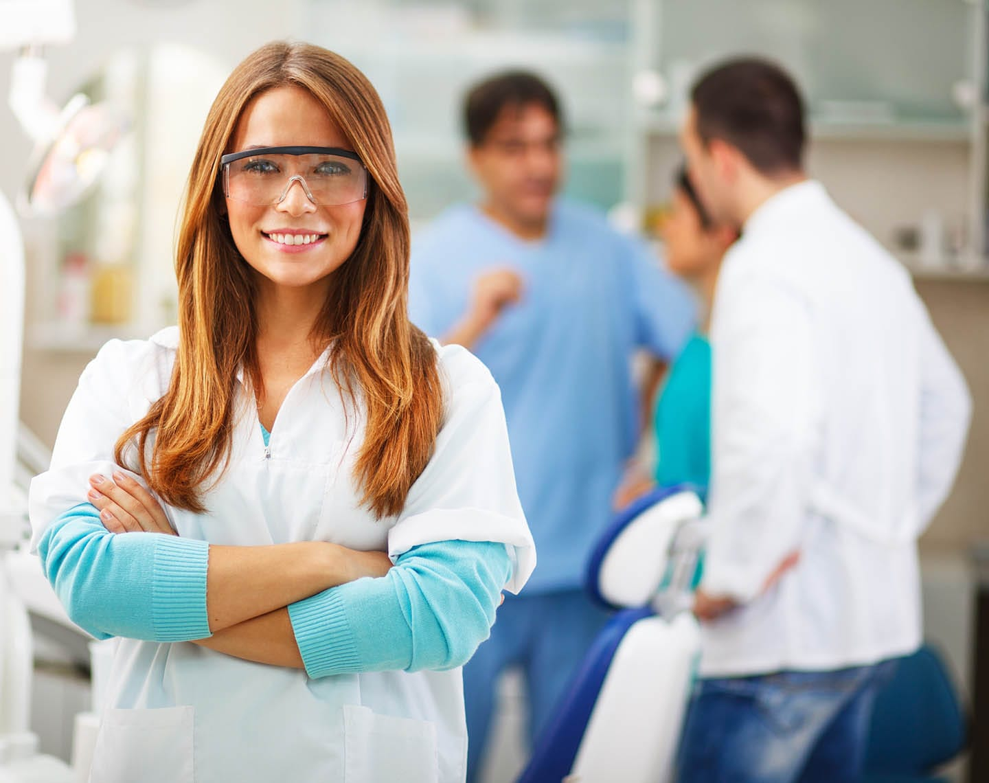 Dental Assistant smiling with arms crossed