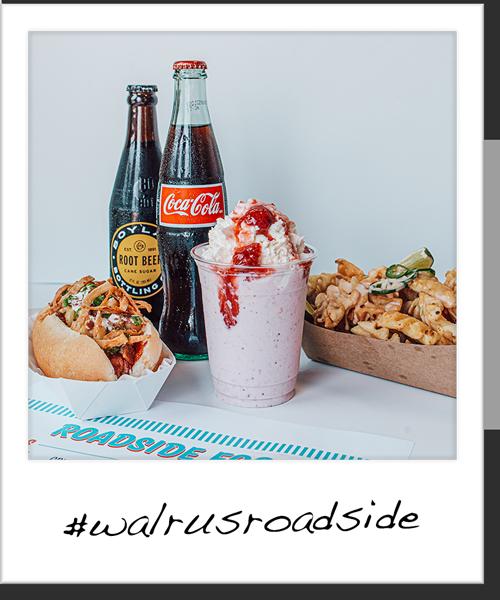 a polaroid style photo of roadside treats: a burger, shake, fries and a coke
