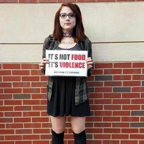 Keira Devine, organizer for Direct Action Everywhere Philadelphia, holding an