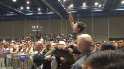 Kearney disrupting a Bernie Sanders rally