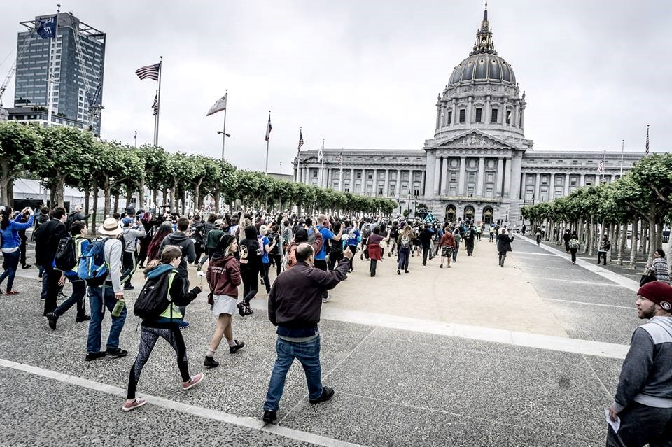 Activists march to City Hall