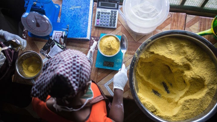 A Liberian woman makes   Power Gari, a fortified ca  ssava porridge made by Just.