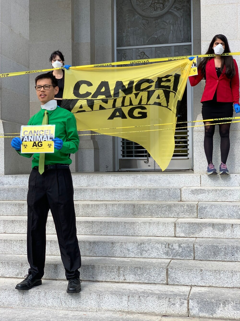 Chinese American activist Rocky Chau speaks at Tuesday's protest