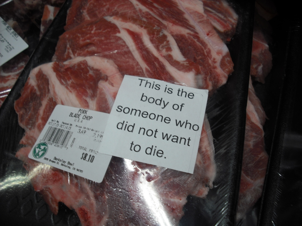 A package containing animal flesh has a sticker on it that reads