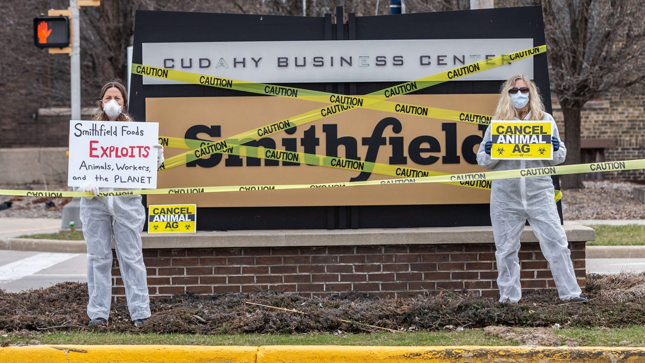 Protest outside the Smithfield Patrick Cudahy slaughterhouse on Friday, April 3, 2020. The group is protesting unjust and unsafe labor practices at the facility which employs more than 1,000 workers.