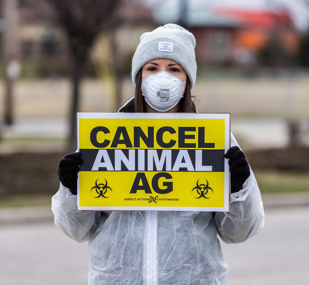 Activist protesting outside the Smithfield Patrick Cudahy slaughterhouse in Cudahy on Friday, April 3, 2020. The group is protesting unjust and unsafe labor practices at the facility which employs more than 1,000 workers.