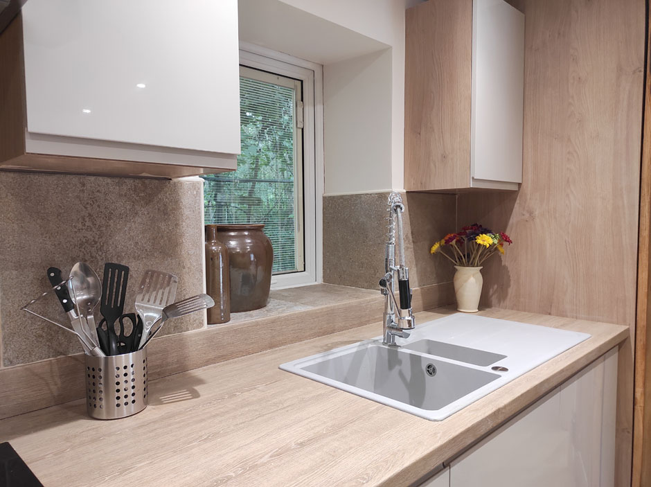 The kitchen sink area with its window