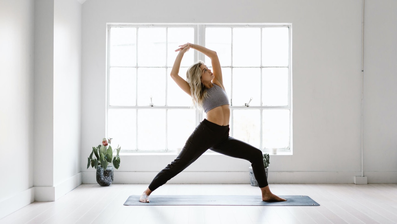Blonde woman doing yoga