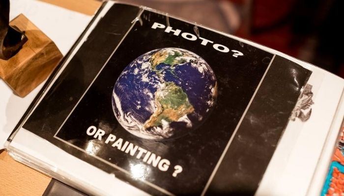 A picture of the earth with the words 'photo or painting?'