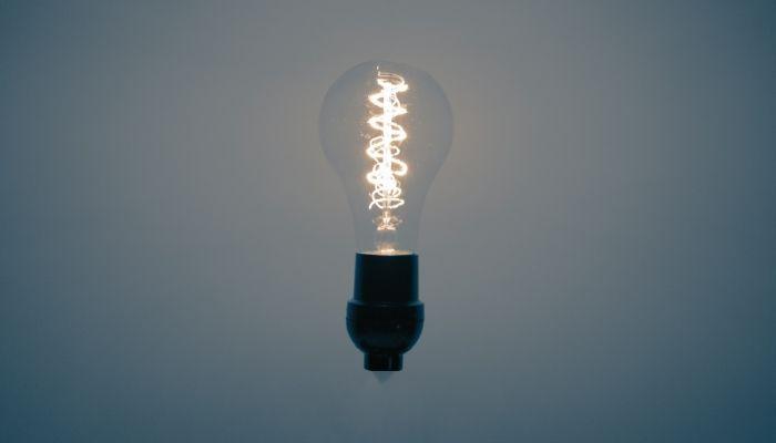 A single illuminated lightbulb