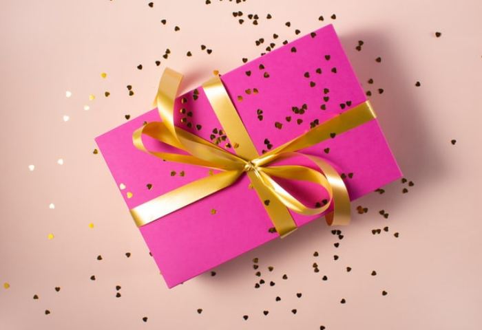 A present wrapped in pink paper