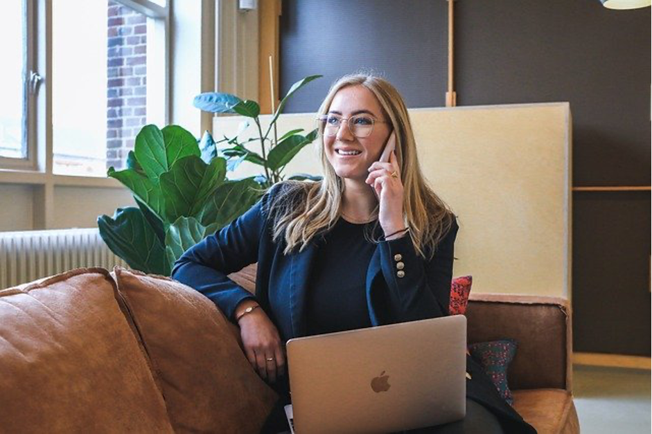 Woman working from home with remote device