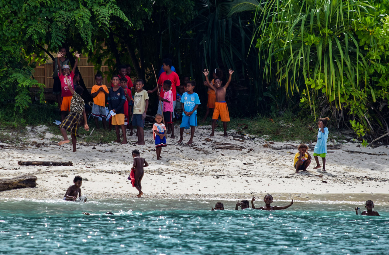 Boys from the local village Enyar enjoying their weekend and cheering at our boat