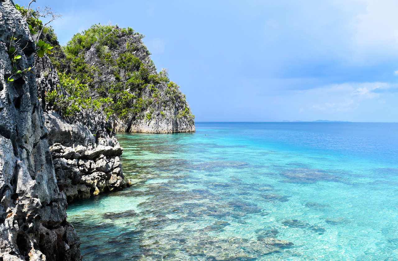 Typical coastline in Raja Ampat, turquoise waters and rocky formations