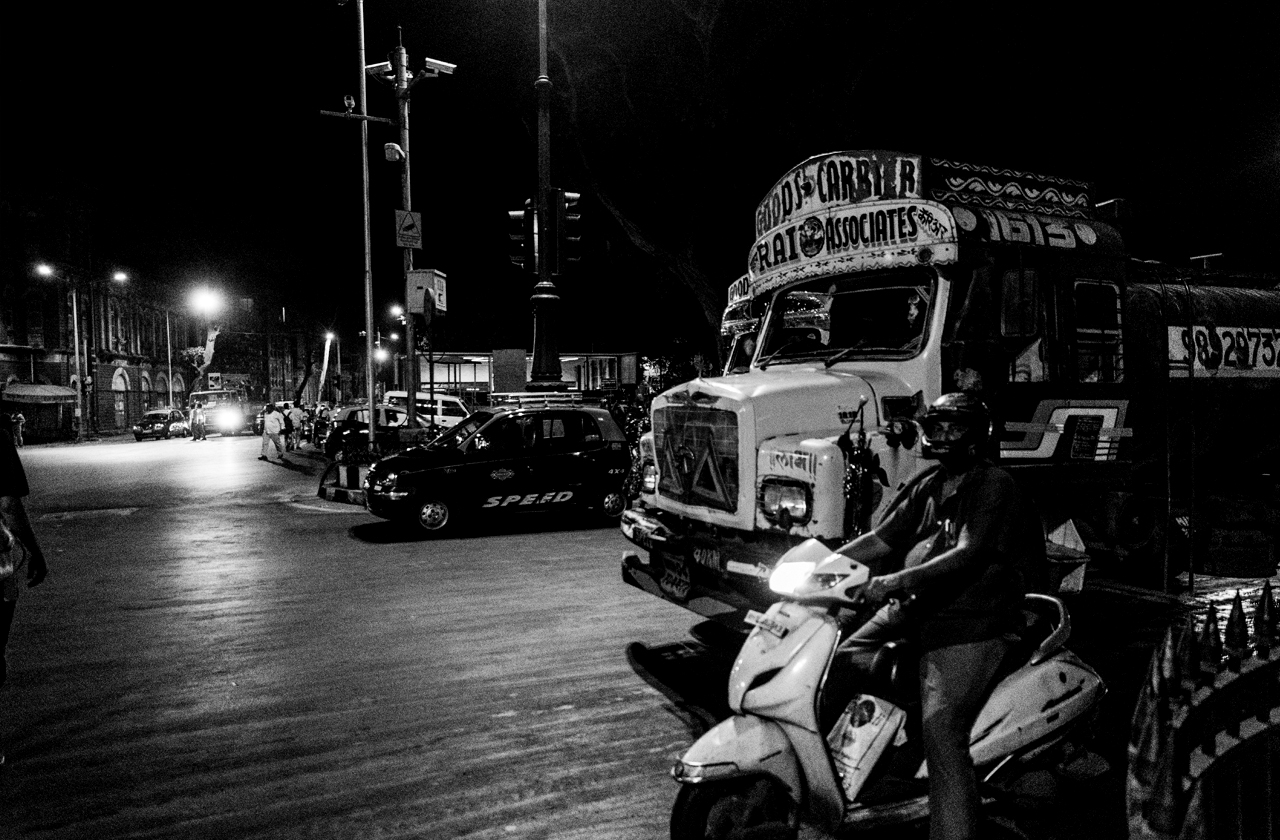 Busy junction in front of Chhatrapati Shivaji Terminus railway station features some vintage vehicles.