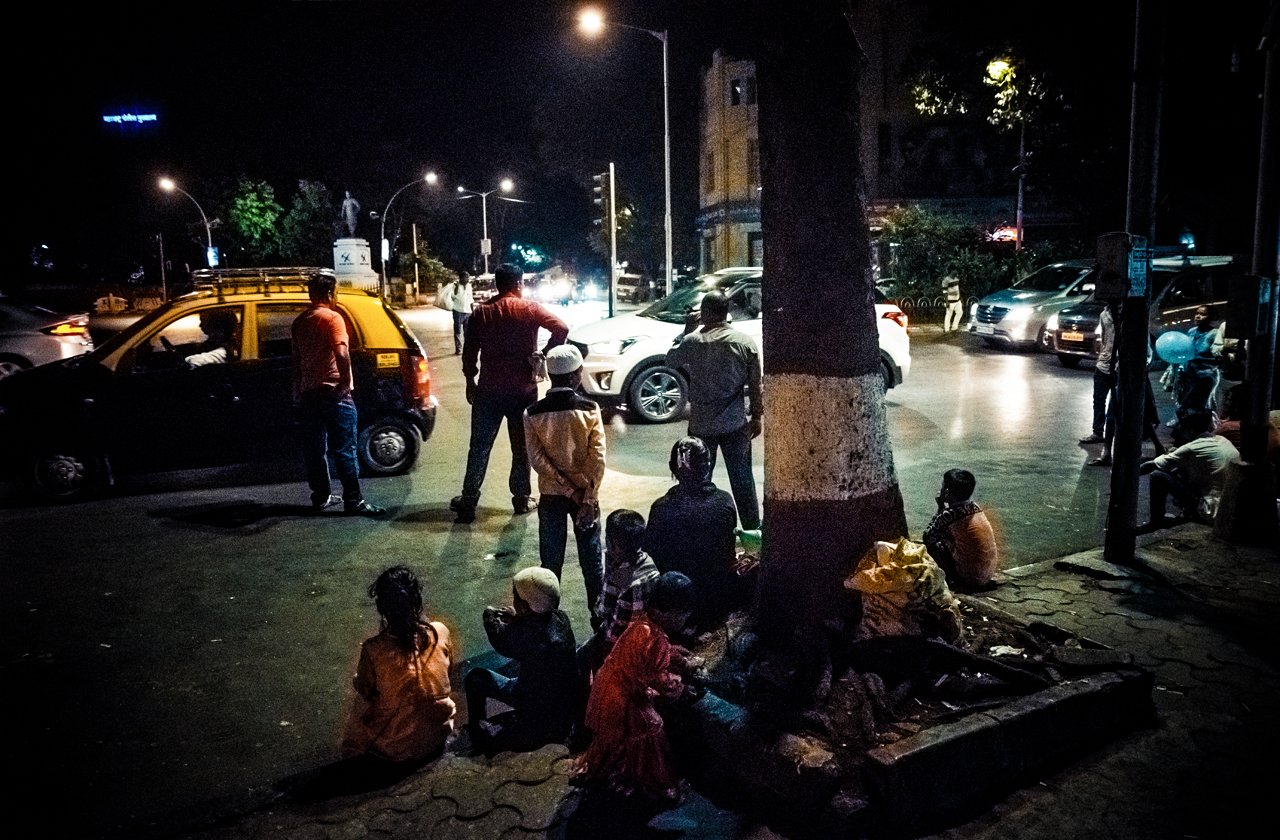 Mumbai is full of little children playing on the streets at night.