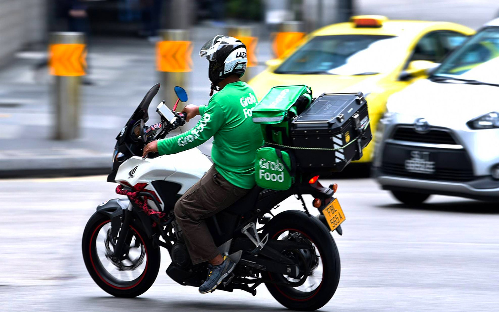 Delivery services in Southeast Asia see spike in business because of COVID-19 (Source: Channel News Asia, Photo: Mediacorp)