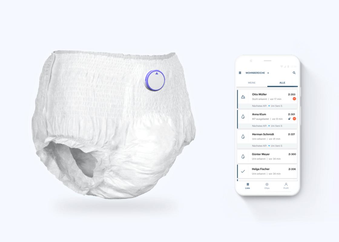 Smartes Inkontinenzprodukt neben Smartphone mit Inkontinenzmanagement-App.
