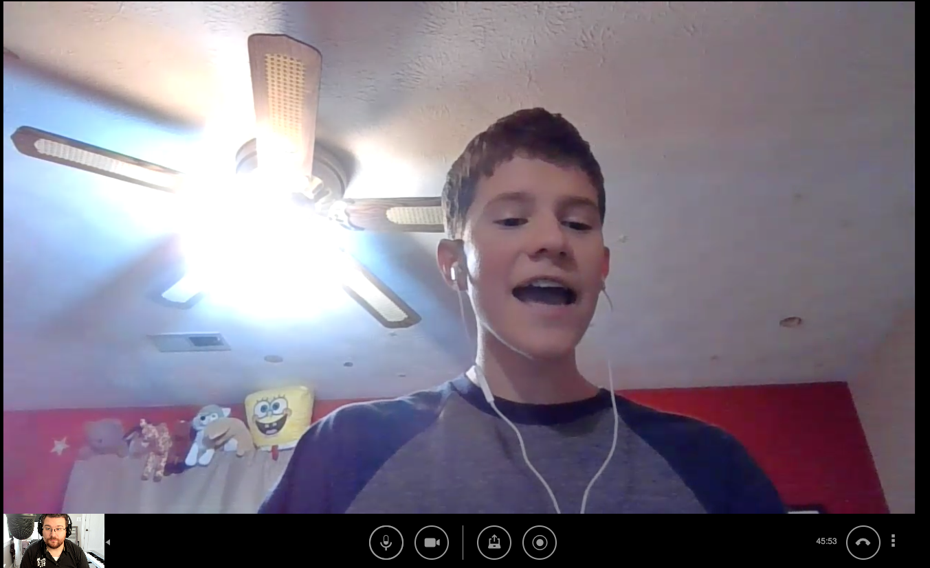 Student singing during online lesson with Manuel Creative Arts Academy.