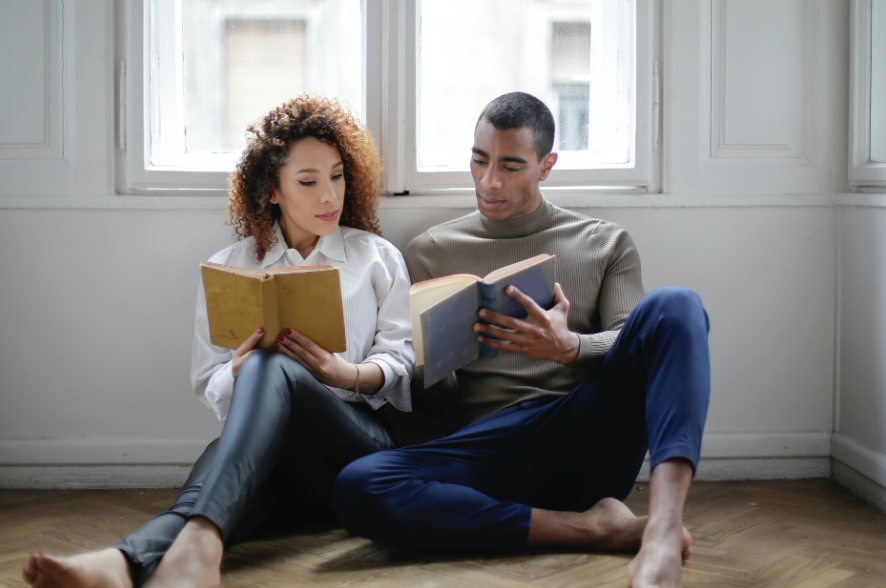 A couple reading the best relationship books