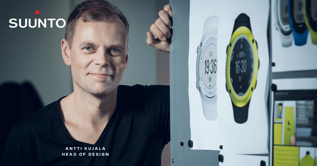 A photo of Antti Kujala, head of design at Suunto and there are prints of sports watch on the wall