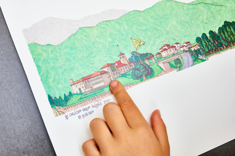 Mano de niña sobre ilustración del Monasterio de San Pedro de Villanueva, en Cangas de Onís, Asturias