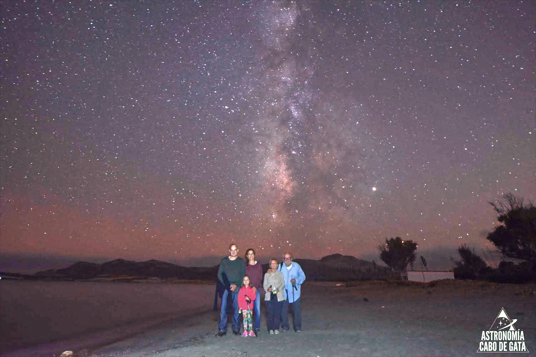 Grupo de personas posando de noche con Via Lactea en la Playa de Los Genoveses de San Jose, Cabo de Gata, Nijar, Almeria, Andalucia