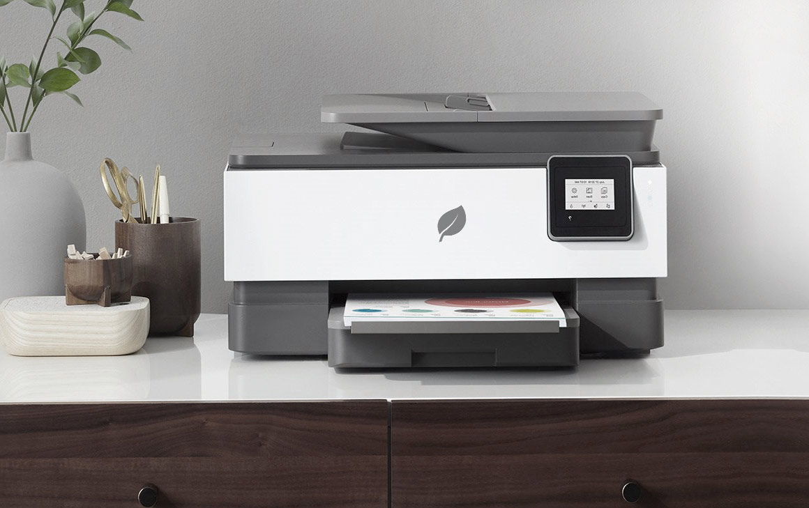 A printer on a stylish home office console.