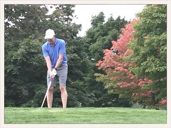 Mike golfing