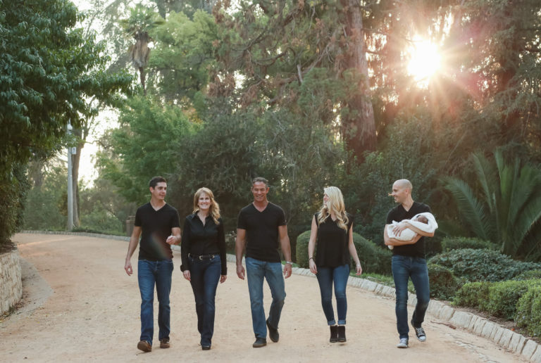 about redlands realty family photo walking in a Redlands park