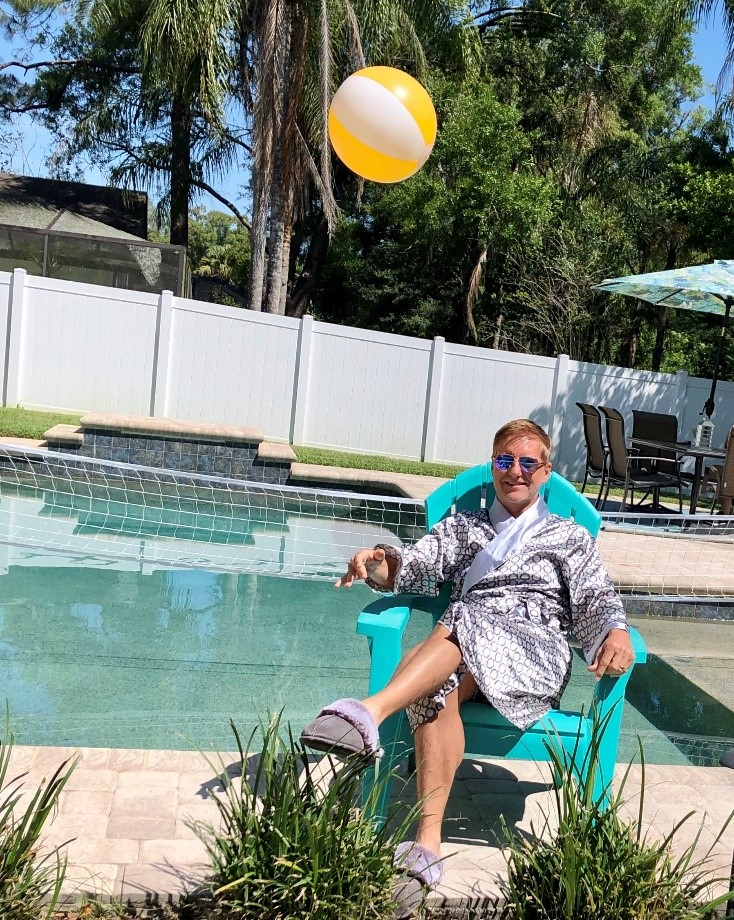 Director of Enrollment Strategy Jim Rogers spends his quarantine lounging by the pool in Florida.