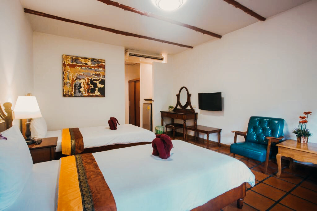 Deluxe bedroom with wooden furniture