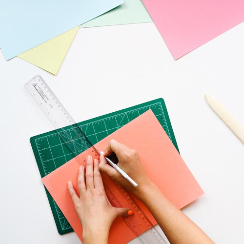coloured paper being cut
