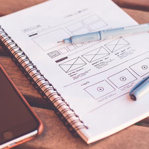 notepad with hand drawn website wireframe