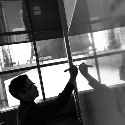 man with white board in black and white