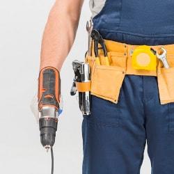 a tradesperson holding a drill