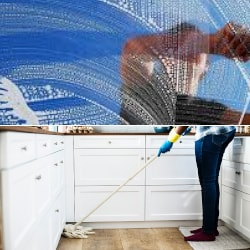 a window cleaner and mopping a floor
