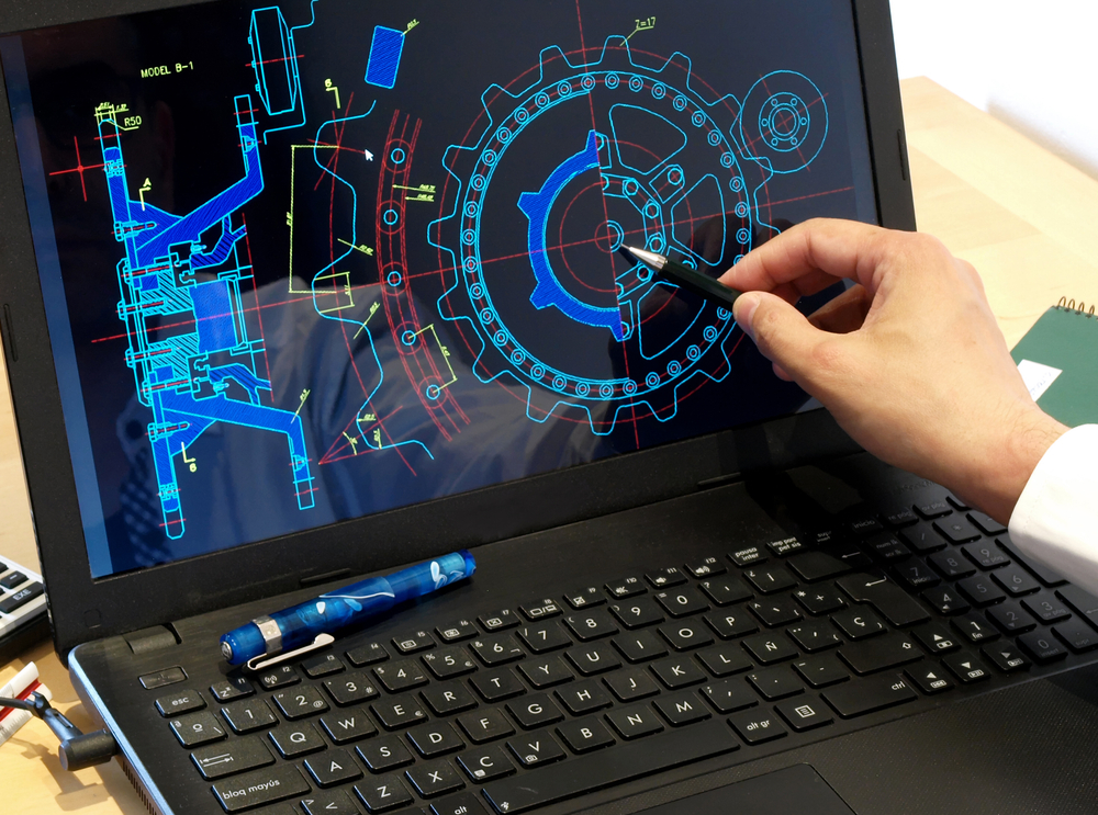 Designer Using CAD on Laptop