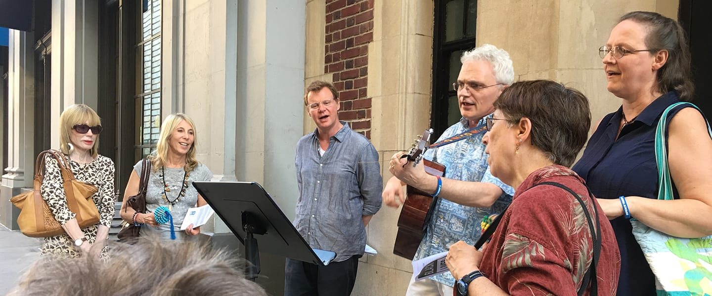 Pastor Andrew and congregants singing outside of Rutgers Presbyterian Church.