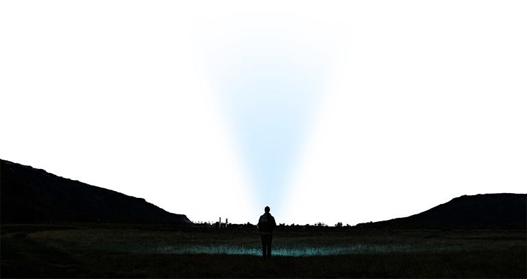 A man looking at the night sky