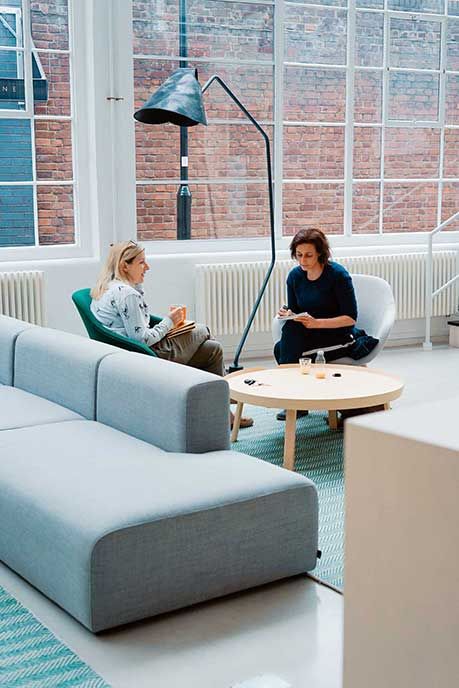 2 woman working at a lounge