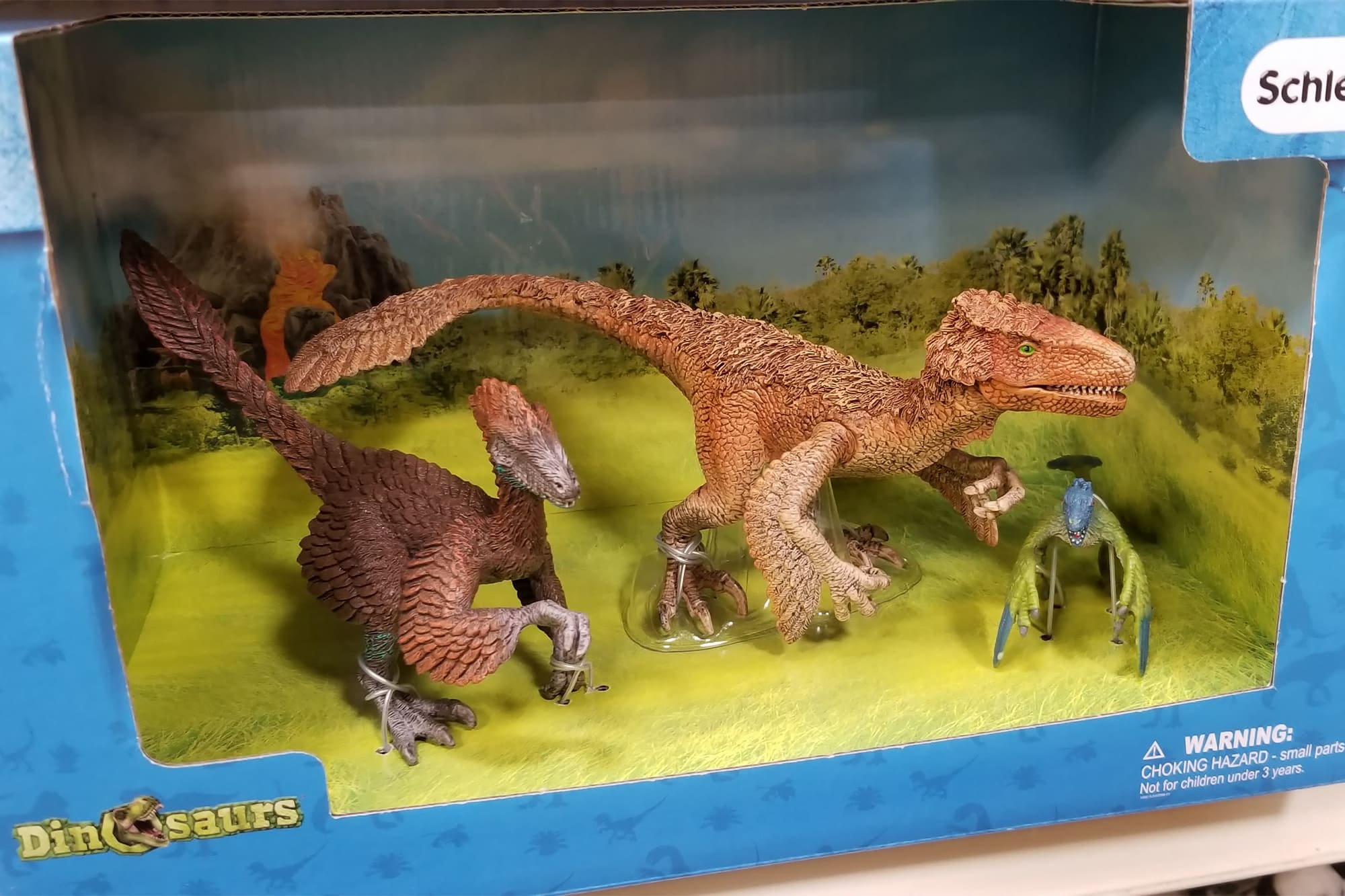 Dinosaur toys with feathers on them