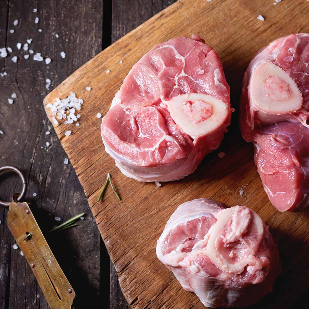 Veal Osso Bucco on timber board. Our fresh meats can be home delivered or click and collect.