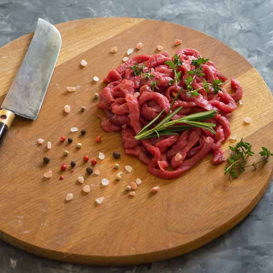 Beef Strip On Wooden Board - Available in 1kg packs and orders can be home delivered.