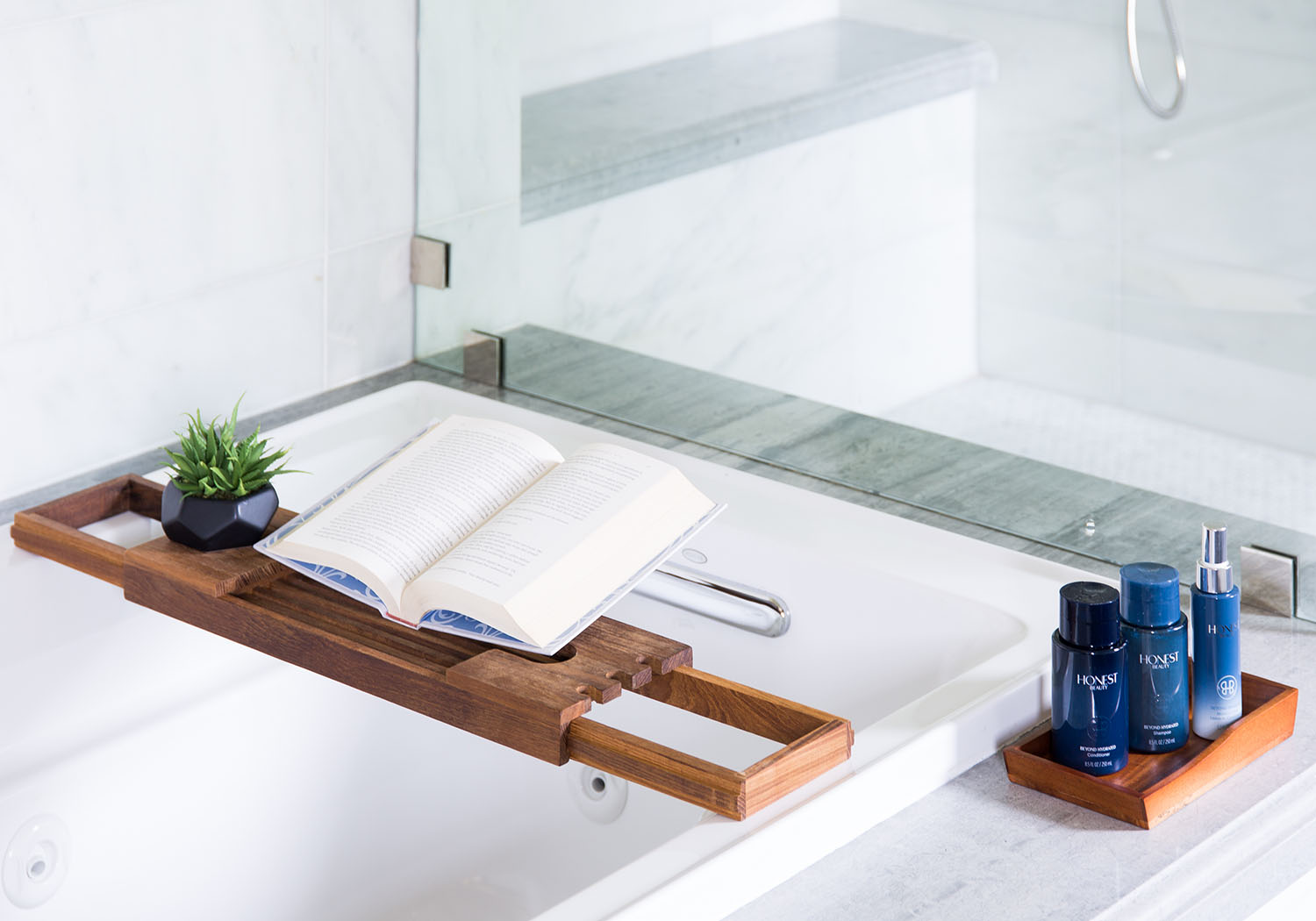 This wooden bath tray can keep your book or phone safe while you relax in the tub.