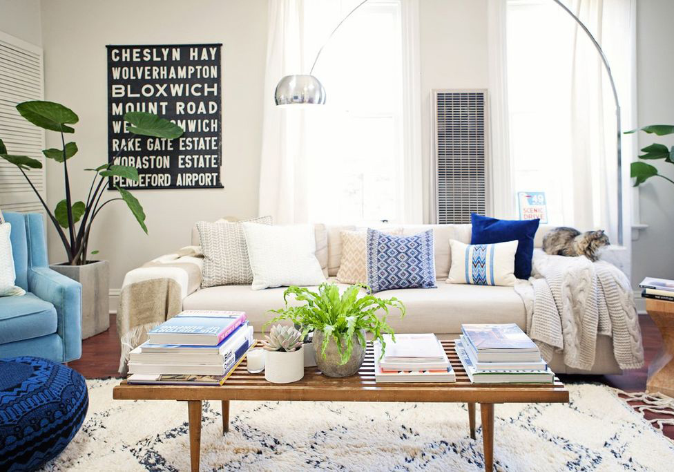 Fresh, green plants like English ivy, rubber trees, and fiddle leaf fig tree add liveliness and positive energy to a space.