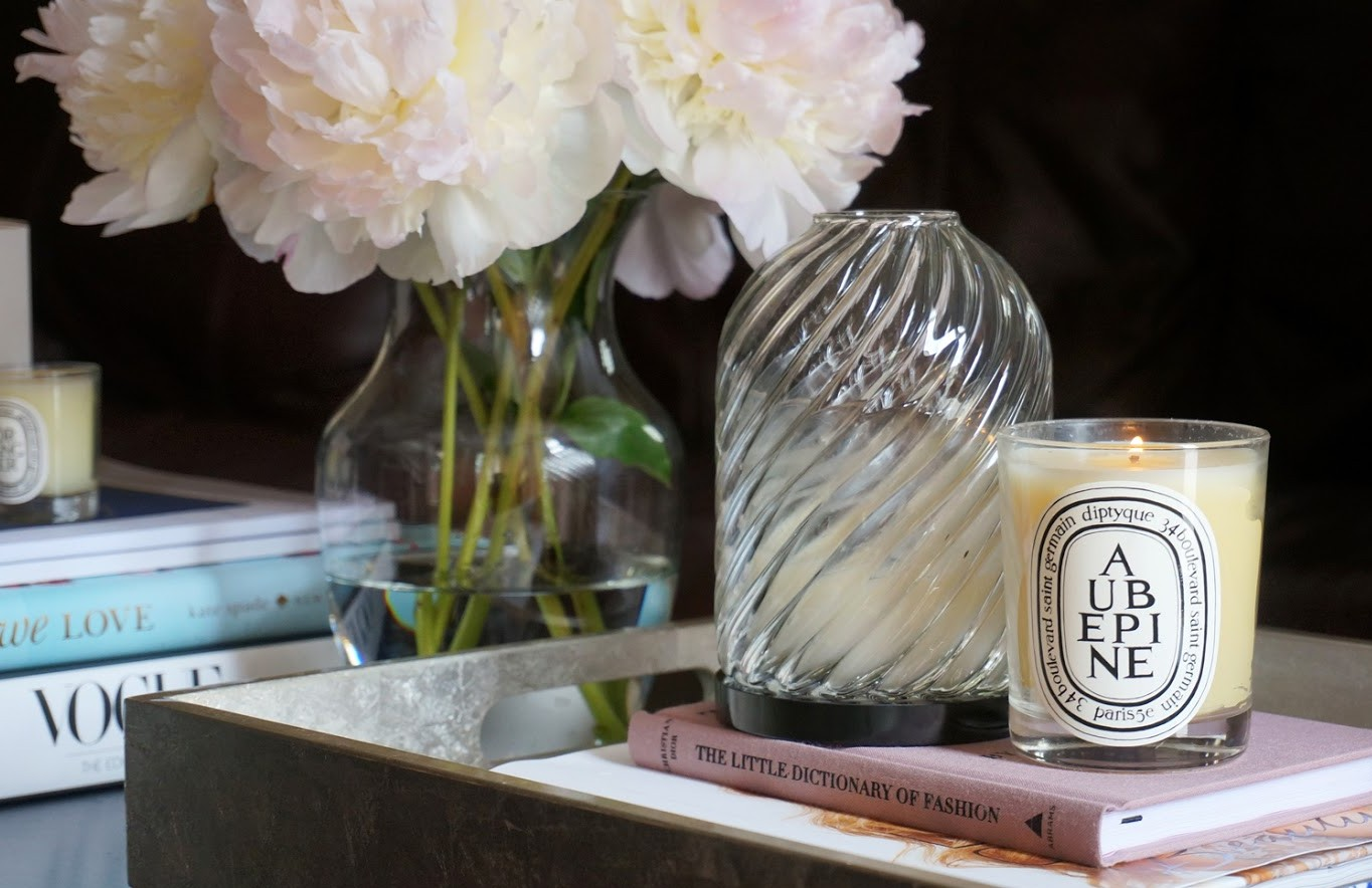 A vase of fresh flowers and scented candles are gorgeous additions to a space.