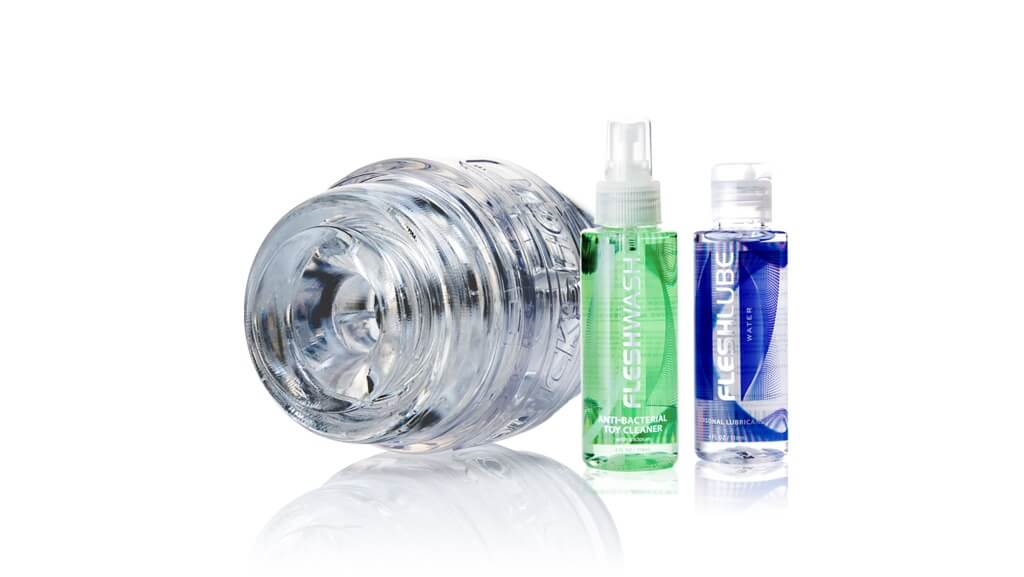 Clear Pulse sleeve, Clear case, Sleeve caps, 4 oz Fleshlube Water, 4 oz Fleshwash Toy Cleaner