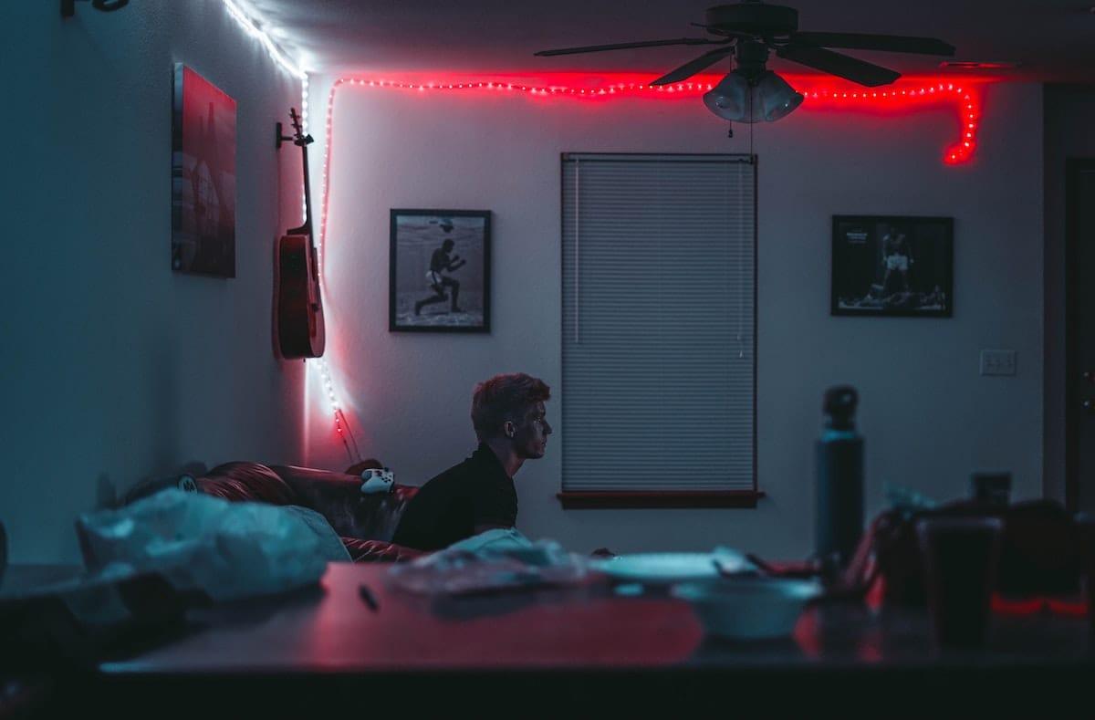 Teenage boy alone in bedroom