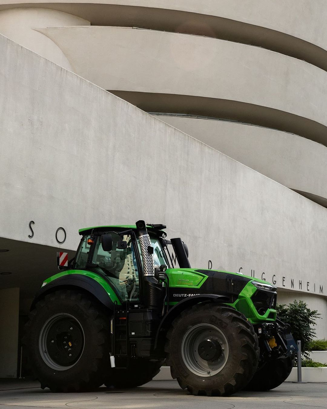 Image of a green tractor outside of the Guggenheim museum. Image found at Adsum NYC.